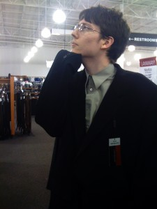 Greg, trying on a way-too-big sports coat.