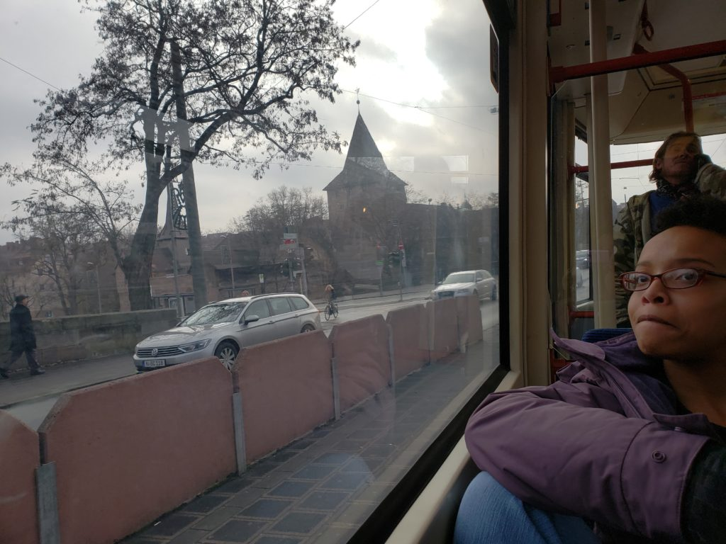Dante sitting in the window seat of a tram in Nuremberg.