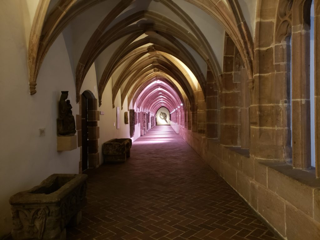 The long hallway of a former monastery that is incorporated into the Nuremberg National Museum.